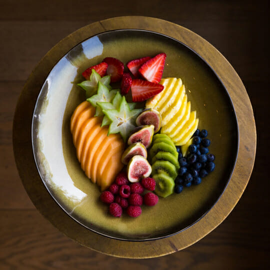 Colourful bowl of beautifully presented sliced fruit